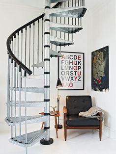 reading nook under spiral staircase