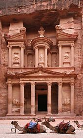Al Khazneh is one of the most elaborate temples in the Jordanian city of Petra.  Carved our of sandstone, it was originally built as a mausoleum and crypt at the beginning of the 1st Century AD during the reign of Aretas IV Philopatris. Its Arabic name (Treasury) derives from one legend that bandits or pirates hid their loot in a stone urn high on the second level.