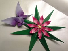 http://creativplace.blogspot.ru/2011/11/origami-spring-star-with-butterfly-by.html