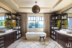 The master bathroom at Kourtney Kardashian's California home, which she shares with her three young children, features his-and-hers vanities, as well as matching shelves to store bath essentials.