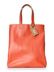 I don't like to take my expensive handbags out when its raining, but this tote from Hunter (the maker of wellies) is a practical & stylish alternative.  Made of rubber it comes in several different colors. (195.00)  I'm adding this to my accessory closet!