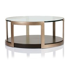 Product Info Dimensions Construction MANHATTAN GLASS TOP ROUND COFFEE TABLE Artisan metal wraps this circular table with chic retro style, with a rich matte gol