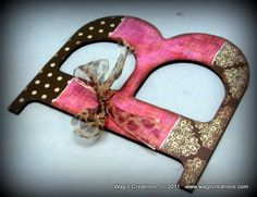 Customize your initial with scrapbook paper and Mod Podge.