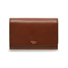 Shop the Medium Continental Wallet in Oak Natural Grain Leather at Mulberry.com. This is a new and compact version of our popular Continental Wallet. It features the new logo design on the front, and is beautifully nappa lined inside.