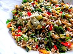 Spring farro salad with roasted peppers, onion, asparagus, artichoke, zucchini, peas & herbs and lemon