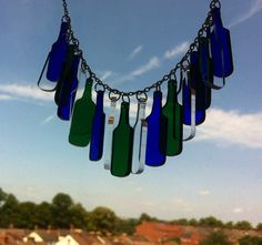 Bottles charm necklace on Etsy, £18.00