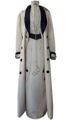 Edwardian two piece walking suit. The suit consists of a long length skirt with early hook & eye closure in back. Unusual abstract pleating with decorative silk fabric button with toggle style looping. Matching full length, duster style jacket with navy blue silk boater style lapels. Designed with a diagonal pattern to grace each coat side. Decorated with matching toggle style buttons.