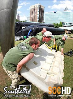 Employees Of Southern Outdoor Cinema Put Into Place One Four 1200 Pound Anchors While Setting