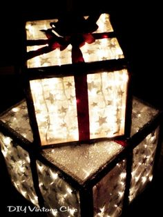 Outdoor Lighted Christmas Presents DIY these trendy holiday decorations with some wood, outdoor lights, and ribbon. Once you create the boxes in your desired dimensions, stuff some Christmas lights inside and wrap the exterior. Christmas Porch, Noel Christmas, Rustic Christmas, All Things Christmas, Winter Christmas, Christmas Lights, Christmas Boxes, Christmas Ideas, Simple Christmas