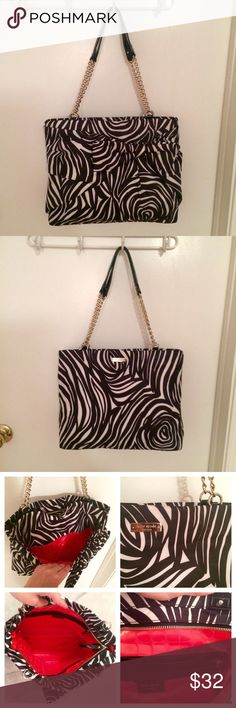 Kate Spade Nylon Tote Zebra Kate Spade Nylon Tote Zebra. Bag has a bow feature on the front. Inside is a vibrant orange. Authentic and in great condition! kate spade Bags Totes