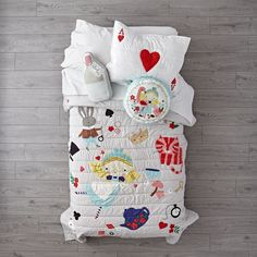 Shop Wonderland Quilt. Follow Alice down the rabbit hole into Wonderland, and you'll find this quilt set inspired by Lewis Carroll's classic story. It features appliquéd and embroidered elements, and the sham is designed to look like the Ace of Hearts.