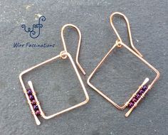 These square spiral hoop earrings are copper with wire wrapped metallic purple iris glass beads on one side. These square spiral hoop earrings are copper with wire wrapped metallic purple iris glass beads on one side. Copper Earrings, Beaded Earrings, Earrings Handmade, Beaded Jewelry, Hoop Earrings, Handmade Jewellery, Handmade Wire, Stud Earring, Diy Metal Earrings