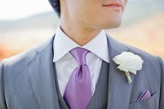 Pair your groom's suit with purple accents.