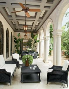 Ken Tate created this classically inspired loggia during the renovation of a home he had originally designed. French doors in the living and dining rooms open onto the gracious space and echo the arches of the colonnade. (July 2010)