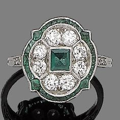 An art deco emerald and diamond brooch and ring, circa 1920