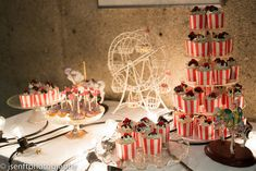 We've seen some amazing carnival weddings, but this one may be in contention for the most epic decor ever. We're talking popcorn, Cracker Jacks, pinwheels, faux flash tattoos, circus-themed centerpieces, a hot dog stand, a huge and gorgeous candy buffet, and a retro circus cage photo booth! It will make you want to hop on a ferris wheel and get hitched, vintage carnival-style.
