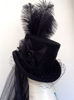 All black  top hat with a merry widow face veil, taffeta band and front corsage, band, bustle and veil with a crown of black ostrich plumes   hand made in my workshop in Scotland  https://www.etsy.com/uk/shop/Blackpin?ref=hdr_shop_menu | Shop this product here: spree.to/45e | Shop all of our products at http://spreesy.com/JabberDuck    | Pinterest selling powered by Spreesy.com