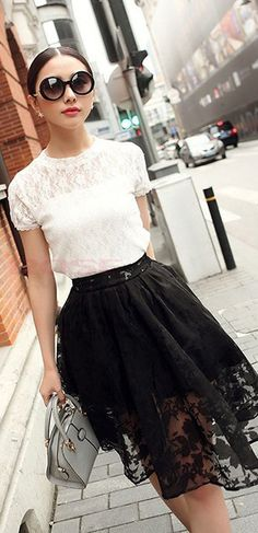 Lace white blouse and lace black mid-length skirt