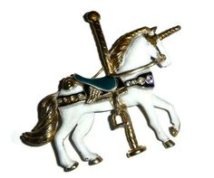 Hey, I found this really awesome Etsy listing at https://www.etsy.com/listing/222009160/vintage-unicorn-brooch-pin-carousel
