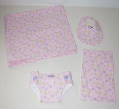 Bitty Baby Essentials in Pastel Garden- Diaper, Bib, Burp Cloth and Receiving Blanket. $14.00, via Etsy.