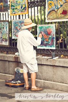 A man painting in the French Quarter in New Orleans, Louisiana
