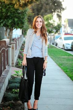 White and navy striped blazer, heather gray v neck tee, gold statement necklace, black crop pant skinnies, and black heels