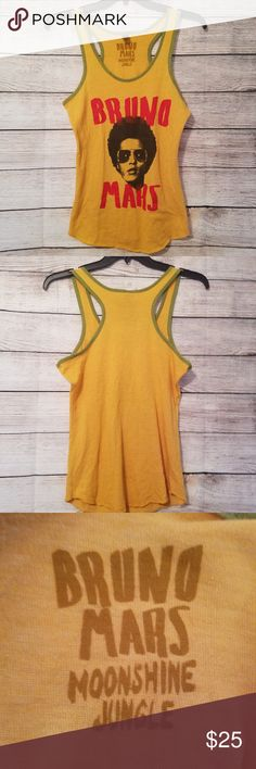 Women's L Bruno Mars Moonshine Jungle Tank Women's L Bruno Mars Moonshine Jungle 24k Magic Yellow Tour Tank Top Shirt  This item is pre-owned and in good condition.  Please know your measurements before bidding!  Chest measures: 38 inches relaxed Length: ~28 inches from top of shoulder to hem.  Comes from a non smoking, pet friendly home! Alternative Earth Tops Tank Tops