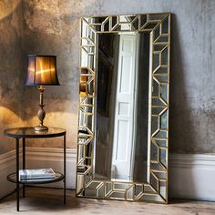 Add some wow factor to your home with this stunning leaner mirror. With its striking geometric mosaic frame, each piece of glass has a bevelled edge encased in the antique gold metal frame. Simply stand against a wall to create an impressive focal point or can be hung if desired. A beautiful example of a leaner mirror which would look amazing in a bedroom, large bathroom, hallway or lounge. Measures: Height 158cm, Width 80cm. Delivery Charge: £20.00 Mainland UK Only. #mirror £375