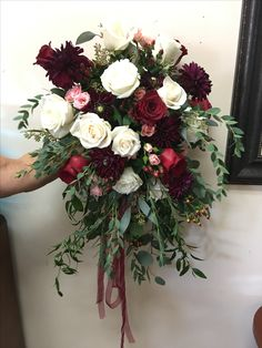 Dahlias garden import white roses burgundy red roses coffee bean and assorted eucalyptus formed in a nosegay for a bridal bouquet
