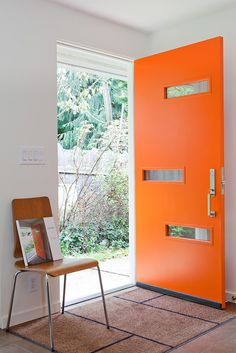 Mid Century-inspired #orange front door by Crestview Doors, Austin TX