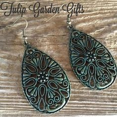 """Filigree Medallion Earrings Distressed turquoise / antique brass finish. Made by yours truly. (Tulip Garden Gifts). Medallion measures 2"""". (2.5"""" overall). Nickel-free hypoallergenic fish hooks. Jewelry Earrings"""