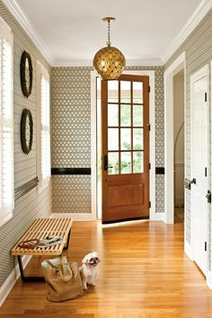 "Be Bold with Wallpaper - 7 Small-Space Makeovers - Southernliving. Designer: Heather Garrett     Size: 96 square feet  Before: The builders' beige hallway had traditional plantation shutters, a chair rail, and an iron chandelier.  The Transformation: ""I decided to make the chair rail an important part of a more modern scheme by painting it glossy black and pairing it with a graphic patterned wallpaper,"" Heather says. Paring down the accessories keeps all eyes on the pattern.  Small-Space…"