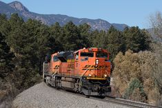 BNSF 9311 leads a load of coal south into Colorado Springs, CO after meeting a northbound counterpart at Academy. Bnsf Railway, Railroad Pictures, Rail Transport, Burlington Northern, Colorado Springs, Locomotive, Santa Fe, Trains, Transportation