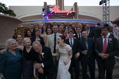 Group Photo in Vintage Vegas Location.  Las Vegas Wedding Planner Andrea Eppolito Events  |  Photo by Corry Arnold  |  Vintage Poolside Wedding at The Flamingo