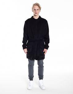 Model is wearing:  black Royals coat & grey Universum sweatpants