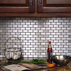 @Overstock - These stainless steel subway tiles spruce up any home improvement project. The Somertile wall tiles feature uneven sides for seamless pattern interlocking.http://www.overstock.com/Home-Garden/SomerTile-11-7-8x11-7-8-in-Chromium-Subway-Stainless-1x2-in-Steel-Porcelain-Mosaic-Tile-Pack-of-10/4211247/product.html?CID=214117 $210.99