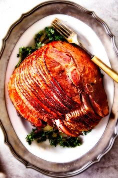 Baked Ham with Apple Cider Maple Glaze: beautifully caramelized, flavorful and deliciously moist baked ham takes minutes to prep and the glaze is out of this world! Perfect for Christmas, Easter and feeds a crowd!