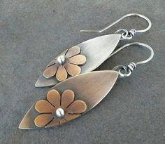 This pretty pair of flower earrings is handmade by me using sterling silver and brass. They measure 2 1/4 inches in length from the top of the ear wire to the bottom of flower dangle. They have been oxidized to show detail and rustic charm.