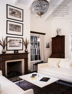 The vintage touches mixed with modern furniture lines creates such a calm, clean space. The ceiling really opens the room up.
