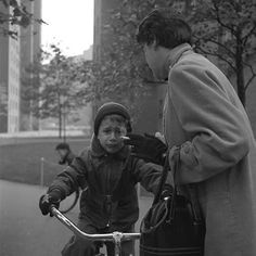VIVIAN MAIER  (Maier was a street photographer in Chicago during the last half of the 20th century.  I admire her ability to be like an invisible eye, capturing what she sees without apprehension.)