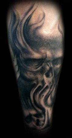 Kelly Doty - Smeary Skulls tattoo