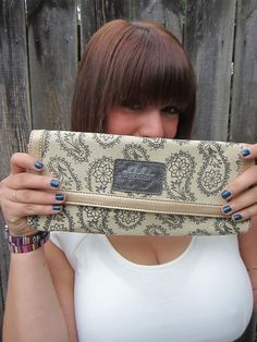Krysten of Why Girls Are Weird Blog  She loves our Daisy Clutch in Graphite