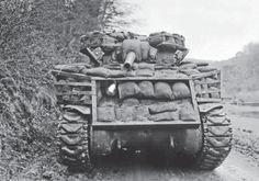 Sherman with improvised sandbag armour