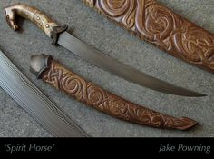 """Spirit Horse"" by Jake Powning.  This short sword/dagger was featured in the first international museum exhibition of international bladesmiths in Macao China. This was his first museum exhibition. He was also awarded an emerging artist grant from the New Brunswick Arts Board in order to construct this piece for the exhibit. The materials are 'flowing water damascus' of 1075/L6 silicon bronze, and curly maple."
