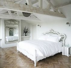 Beautiful Bedrooms in an attic space for extra guests or master suite idea.  Vaulted ceilings with exposed beams.