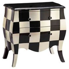 """Bombe chest with a checkerboard design and 2 drawers.  Product: ChestConstruction Material: WoodColor: Black and creamFeatures: Checkerboard designDimensions: 28.25"""" H x 28"""" W x 15.5"""" D"""