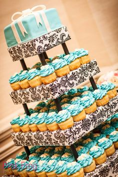 My wedding cupcake tower. Cupcakes from Susies Shortbreads and Tiffany  Co cake topper by @Tamara Walker Cantrill . It was amazing!!!