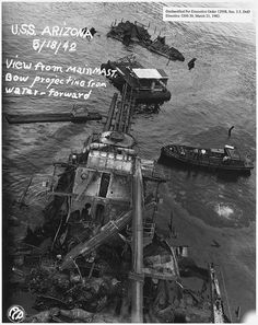 USS Arizona; View from main mast. Bow projecting from water- forward (FCP), 05/18/1942 by The U.S. National Archives, via Flickr