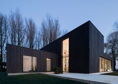 Blackened timber house built on the site of a razed farmstead.