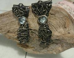 Black si lver handmade eartings, wirh an aquamarine www.eltrebolde4.es